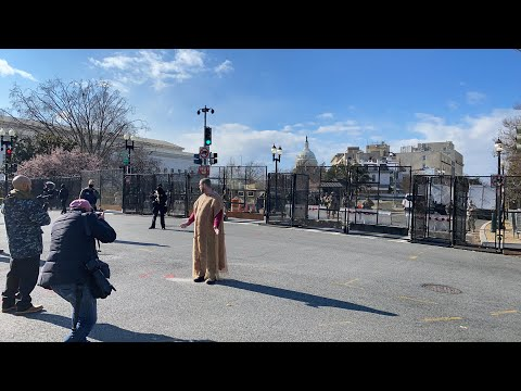Sackcloth mistaken as suicide vest; surrounded by police at Capitol while preaching.