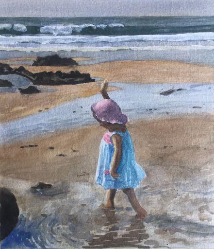 Child paddling at the beach