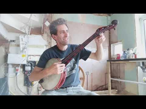 double headed, painted, Boucher minstrel banjo.