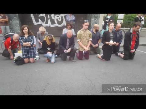 Catholics pray in street.  Black Muslim harrasses them.  Gets knocked out!
