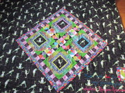 close up of mini quilt on back of All Frogs, No Toads