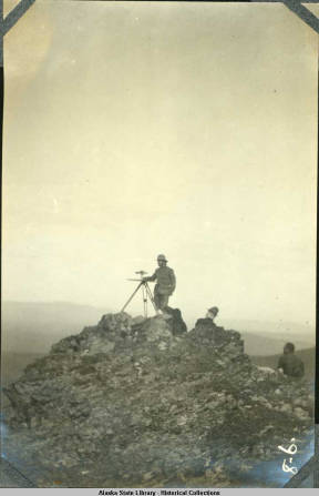 TOPOGRAPHERS ON MOUNTAIN TOP ALASKA CANADA BOUNDARY SURVEY