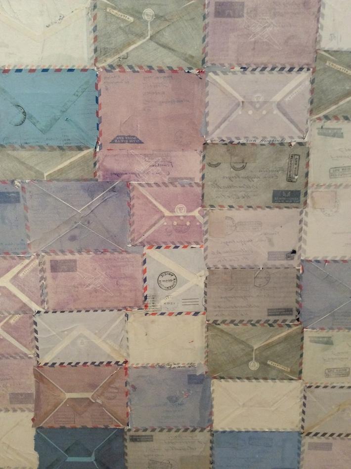 detail of large air mail envelope collage
