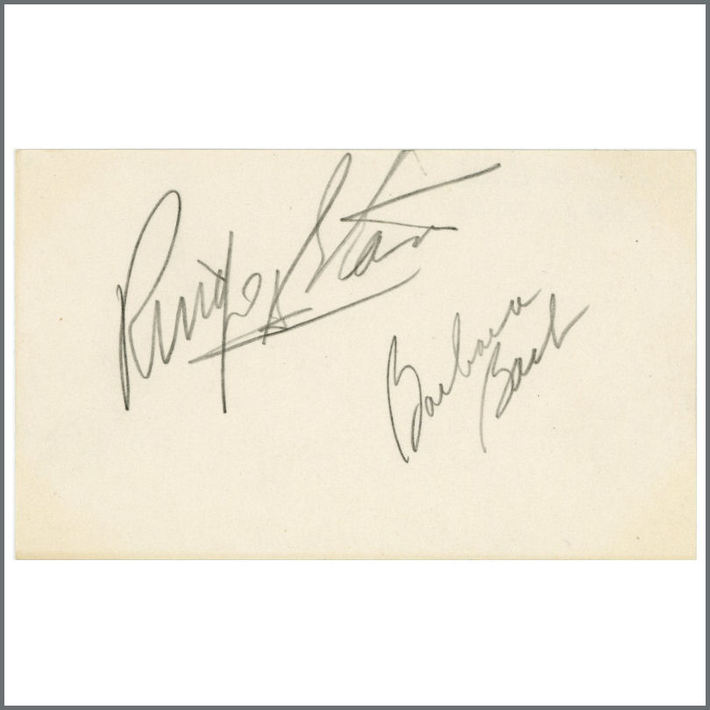 Ringo Starr and Barbara Bach signed white paper.