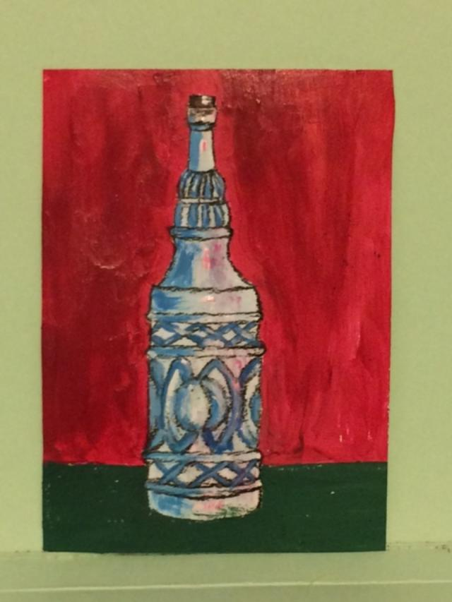 Bottle with red background