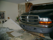 Truck into house
