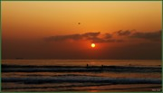 Surfing at sunrise