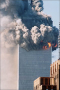 The North Tower, WTC-1, just after alleged collapse  had begun. the exploding bombs are most apparent as are the Thermate-based fires all along the perimeter of the Tower.