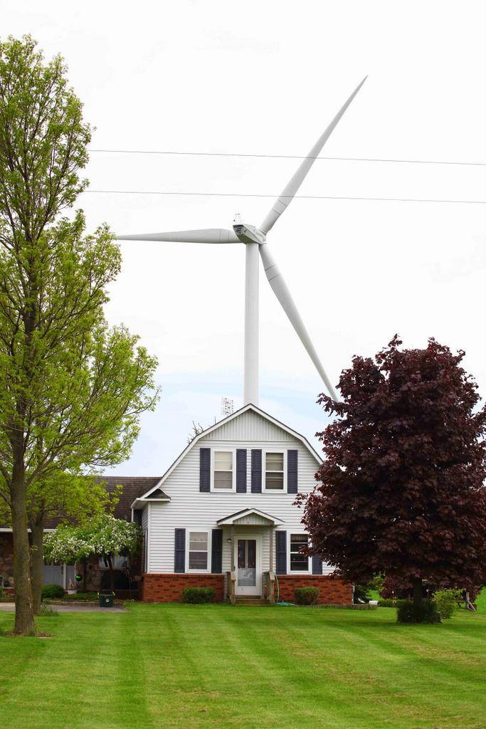 Wind turbine behind farm house