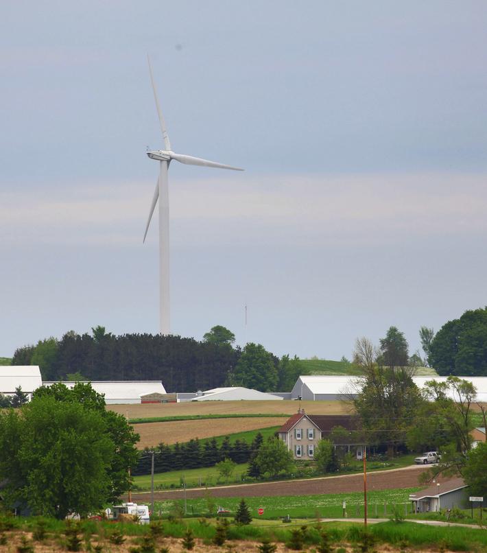 Wind turbine next to farm