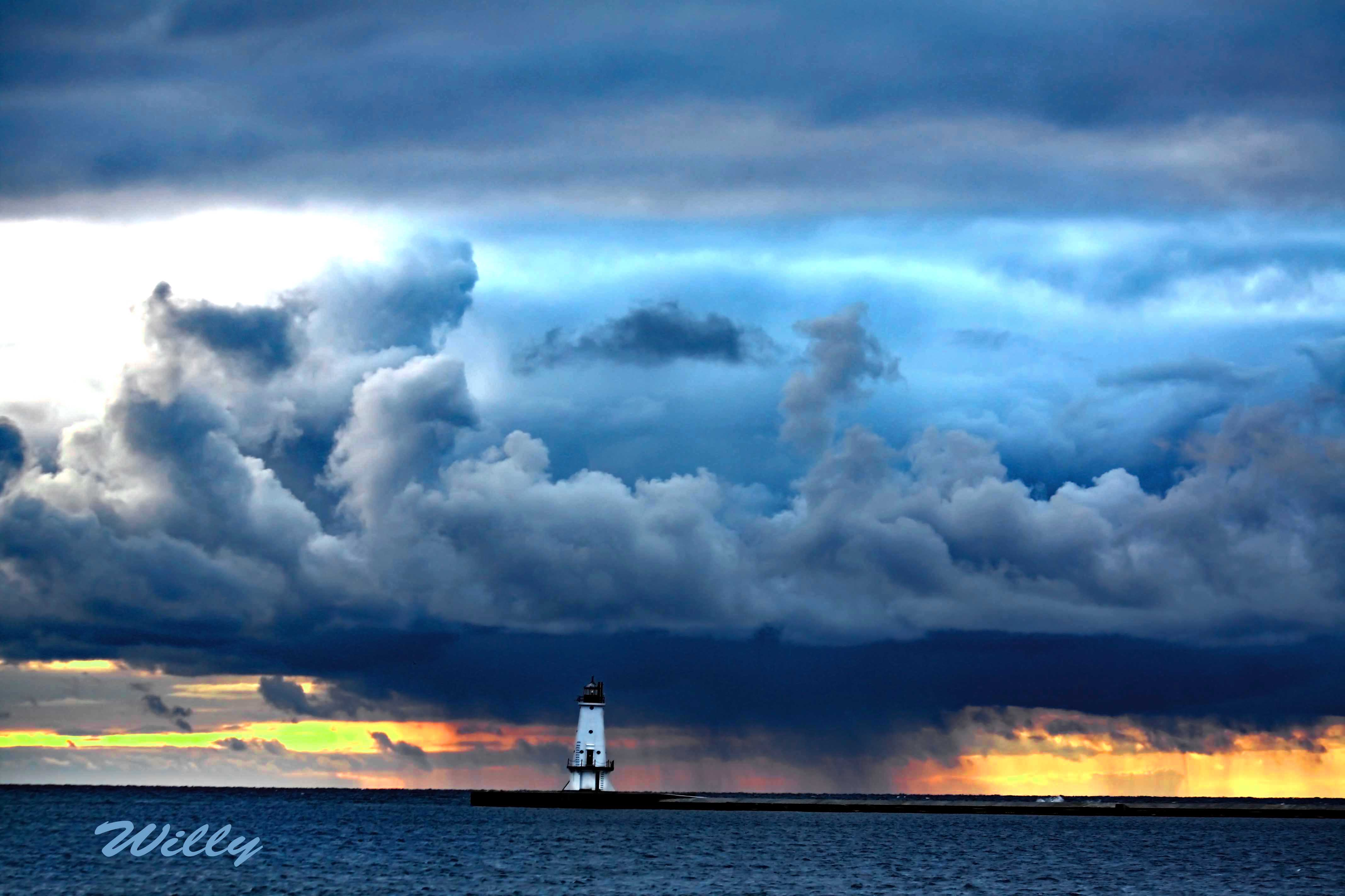 Ludington lighthouse and storm clouds. Michigan