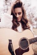 Maggie Baugh - white guitar