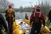 Rescue personnel prepare to deploy rescue boat into river
