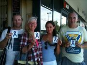 December 2012 Targeted Individuals at Bribie Island, Australia proudly holding Indigo Ribbon Stickers.
