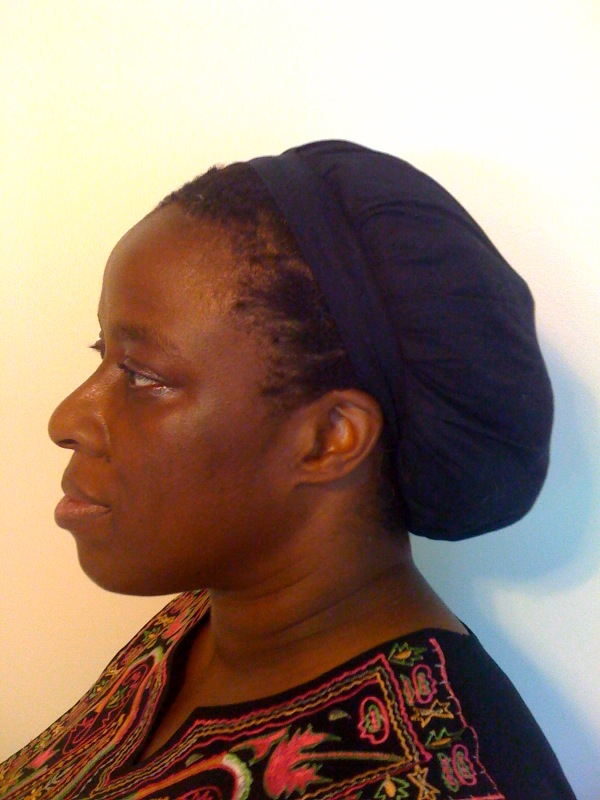 Paula in her cap from Katie's Mercantile Side View Better