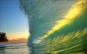 Sun glints off  wave