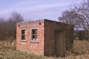 Brick built hut near the 5 milepost