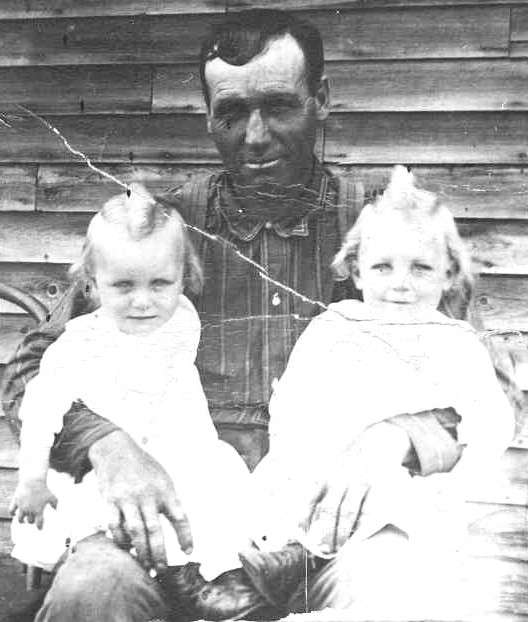 Thomas Andrew Lunney of Easton, Maine and twin sons Ellery and Earl circa 1911