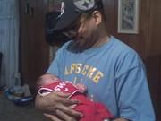 Granpa holding his grandaughter!