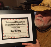 DOC AND THE VETERANS PLAQUE AWARDED TO HIM