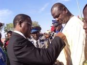 M. Sibiri Bamouni, le chargé de communication du gouverneur recevant une distinction de Chévalier de l'Ordre de Mérite