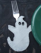 Dollar store placemat with felt ghost applique