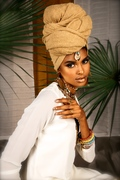 Artist Tierra Benton known as TEA wearing her mothers line of handmade accessories TAUNYABENTONDESIGN