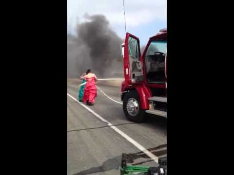 Funny: Firemen in Drag Put Out Truck Fire