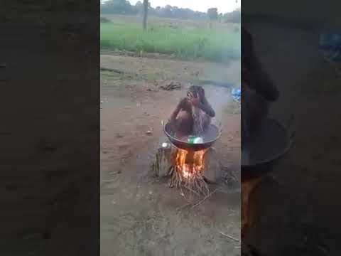 Boy having bath boiling water