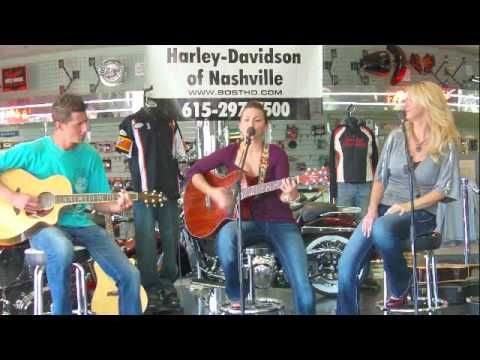 """The band """"Steel"""" playing at the Bost Harley Davidson venue"""