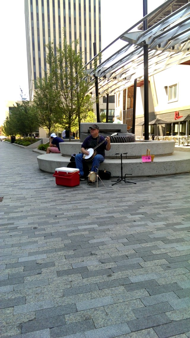 Greenville, SC Street Performer Plays Banjo And Homemade Drums.