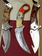 Karambit and 2 Elk Ridge Knives
