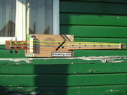 'Bass' ukulele with strimmer lines.