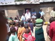 Africa 08 232 Tanzania, Ps Howard & ps Eliah at outreach church announcement