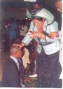 The Bishop being honour by Evang Dr. Mrs. M. O. Agbonifo at FIM