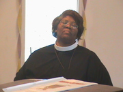 ELDER JENNIFER SHERARD IN CLERGY ATTIRE