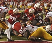 Cody Glenn from Huskers runs against USC