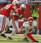 Potter and Asante try to recover football for huskers