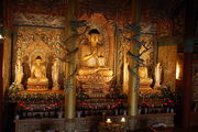 800px-Buddha statues in a temple on Jejudo