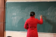 guiyang teacher at chalkboard