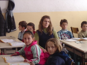 Elementary teacher and students in Kosovo