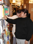 Two students select books