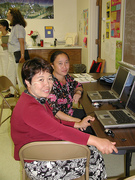 Two Hmong students at computers