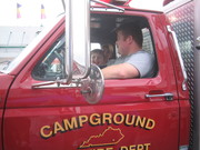Jacob riding with 'Bucket'  in Fire Truck-Chicken Festival Parade