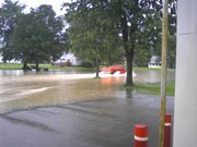 Lt.Caleb French driving his Chevy pickup thru flood water by the station