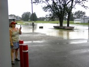 Dispatcher taking pics of water in front of station