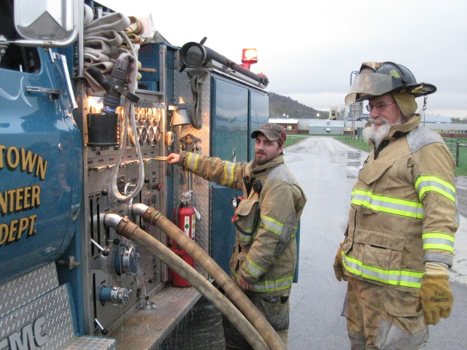 Mikey, and Ron manning the pump.
