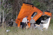 18-wheeler in woods after hit by train
