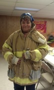 trying on donated bunker gear