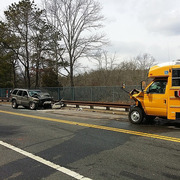 Jeep vs. School bus. No kids on board thankfully